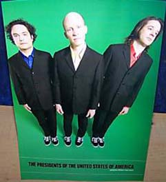 pusa standing in suits on a green background